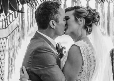 Bride and groom share a first kiss after the wedding