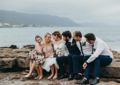 Bridal party share a giggle after the wedding