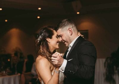 Bride and groom share their first dance during the wedding reception